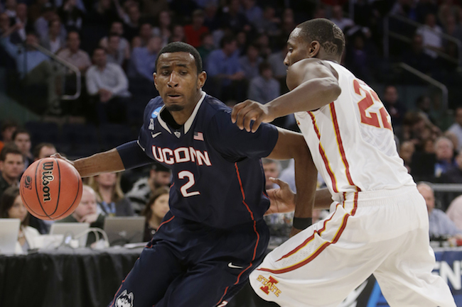 Connecticut's DeAndre Daniels (2) drives past Iowa State's Dustin Hogue (22) during the second half in a regional semifinal at the NCAA college basketball tournament Friday, March 28, 2014 in New York. (AP Photo/Frank Franklin II)