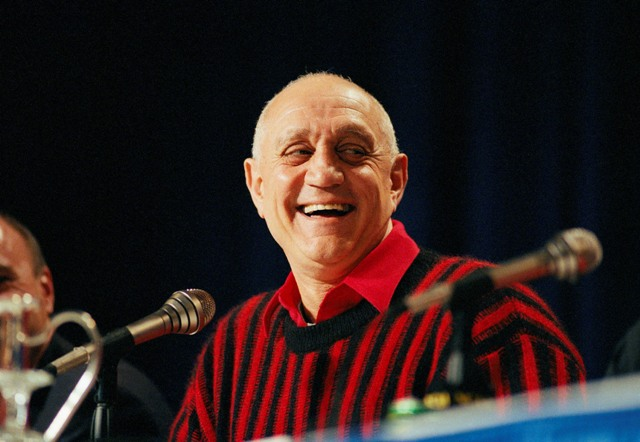 In this April 2, 1990, file photo UNLV head coach Jerry Tarkanian flashes a big smile during a press conference prior to facing Duke in the NCAA Final Four in Denver. Hall of Fame coach Jerry Tarkanian, who built a basketball dynasty at UNLV but was defined more by his decades-long battle with the NCAA, died Wednesday, Feb. 11, 2015, in Las Vegas after several years of health issues. He was 84. (AP Photo/Eric Risberg, File)