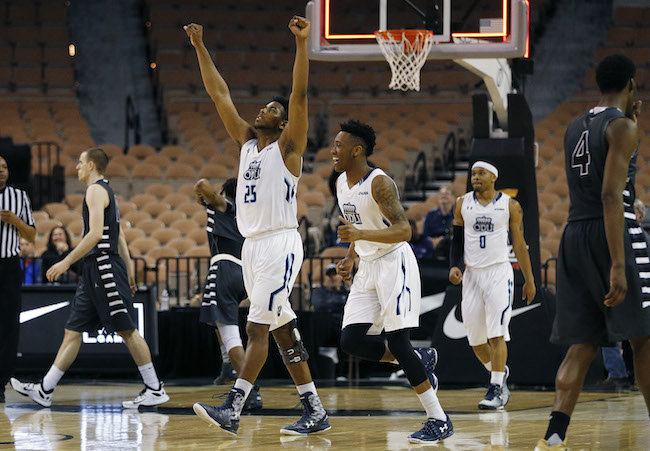Old Dominion forward Brandan Stith (25) celebrates with guard Ahmad Caver, center, and guard Ahmad Caver (0) after Old Dominion defeated Oakland 68-67 in an NCAA college basketball game for the Vegas 16 championship, Wednesday, March 30, 2016, in Las Vegas. (AP Photo/John Locher)