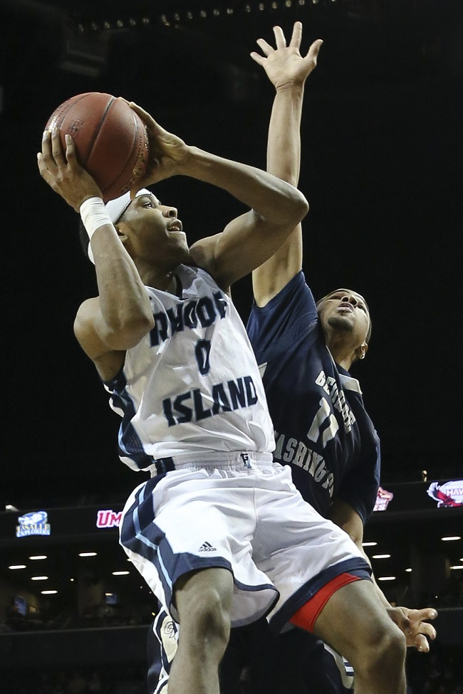 Rhode Island guard E.C. Matthews (0) shoots against George Washington guard Kethan Savage (11) during the first half of an NCAA college basketball game in the quarterfinals of the Atlantic 10 Conference tournament in New York, Friday, March 13, 2015. (AP Photo/John Minchillo)