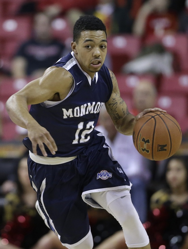 Monmouth guard Justin Robinson drives the ball during an NCAA college basketball game against Maryland, Friday, Nov. 28, 2014, in College Park, Md. (AP Photo/Patrick Semansky)