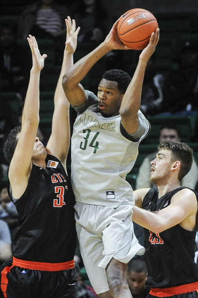 UAB forward William Lee (34) is defended by UTEP forward Ivan Venegas, left, and center Hooper Vint during the first half of an NCAA college basketball game, Saturday, Jan. 9, 2016, in Birmingham, Ala. (AP Photo/John Amis)