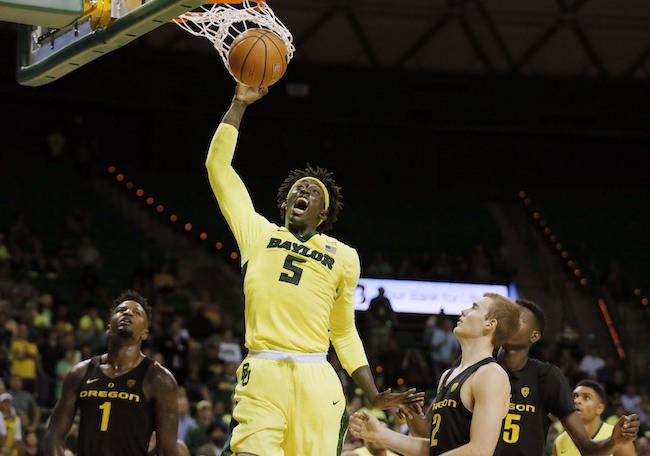 Baylor forward Johnathan Motley (5) celebrates his dunk as Oregon's Jordan Bell (1), Casey Benson (2) and Kavell Bigby-Williams, right rear, watch in the second half of an NCAA college basketball game, Tuesday Nov. 15, 2016, in Waco, Texas. (AP Photo/Tony Gutierrez)