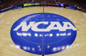 "alt = ""ncaa logo on court"""
